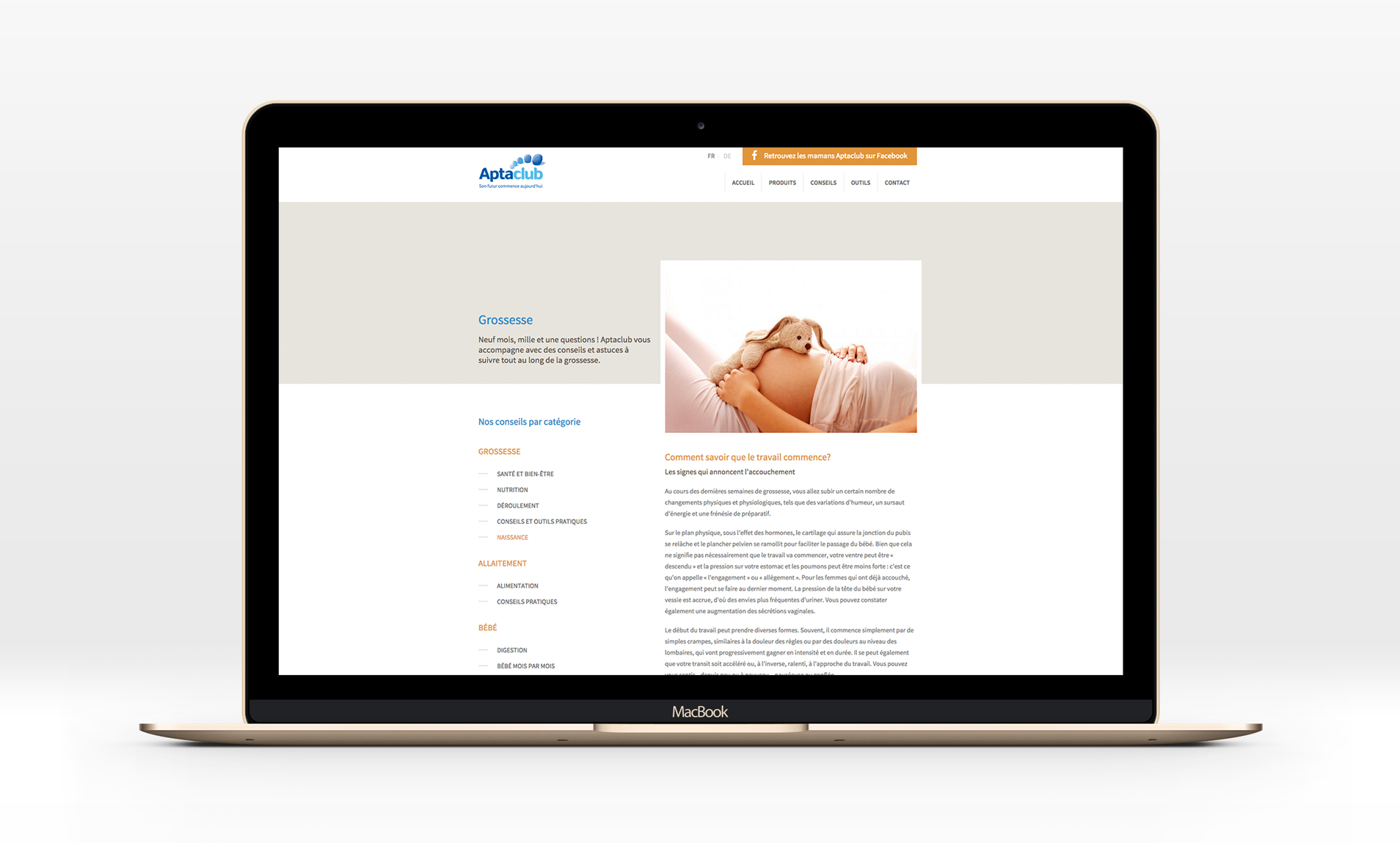 Website Aptaclub on a laptop display